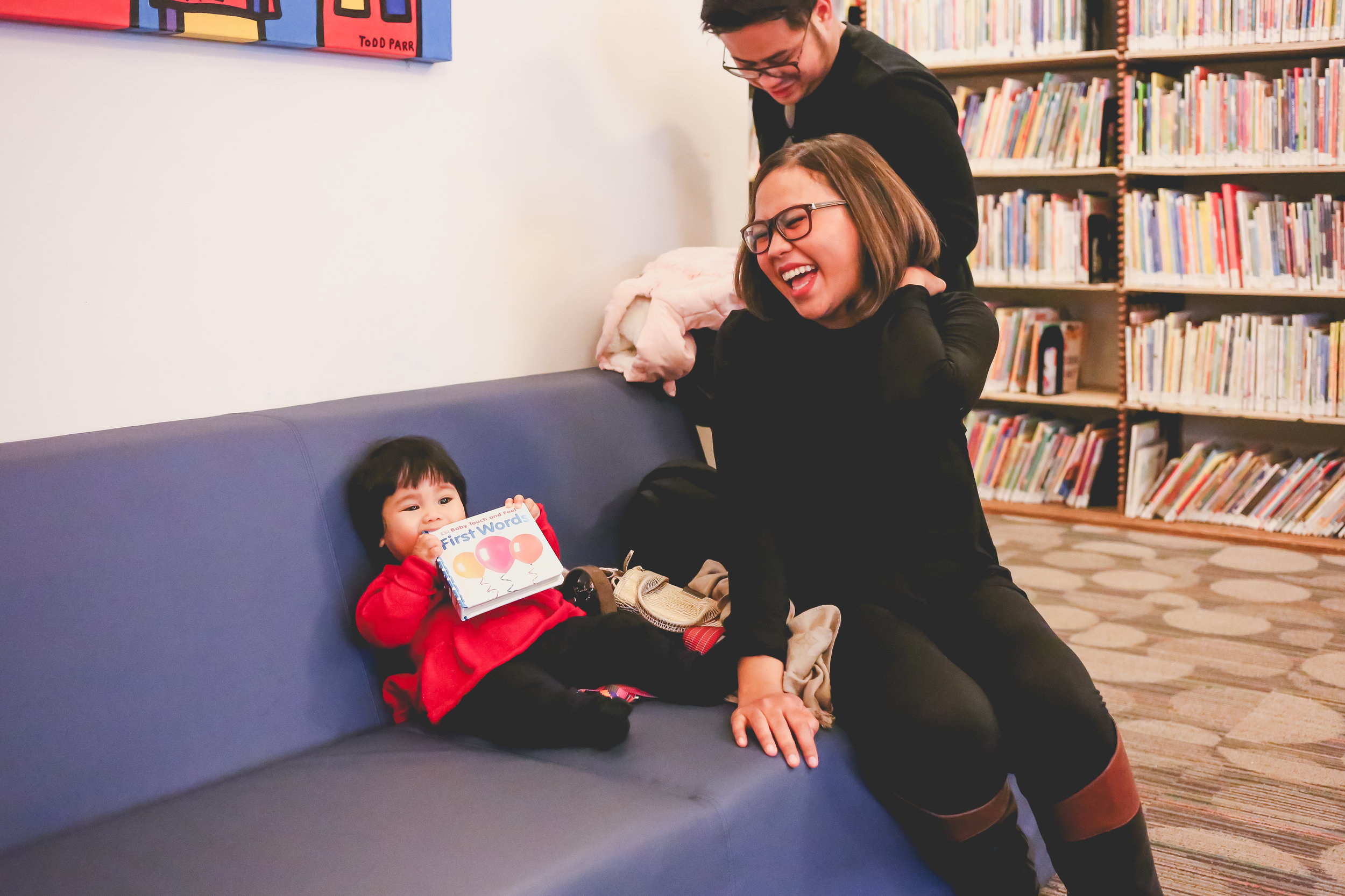 Sharing laughs during a family photography session at the New York Public Library. Photo by Jen Grima, NYC vacation photographer.