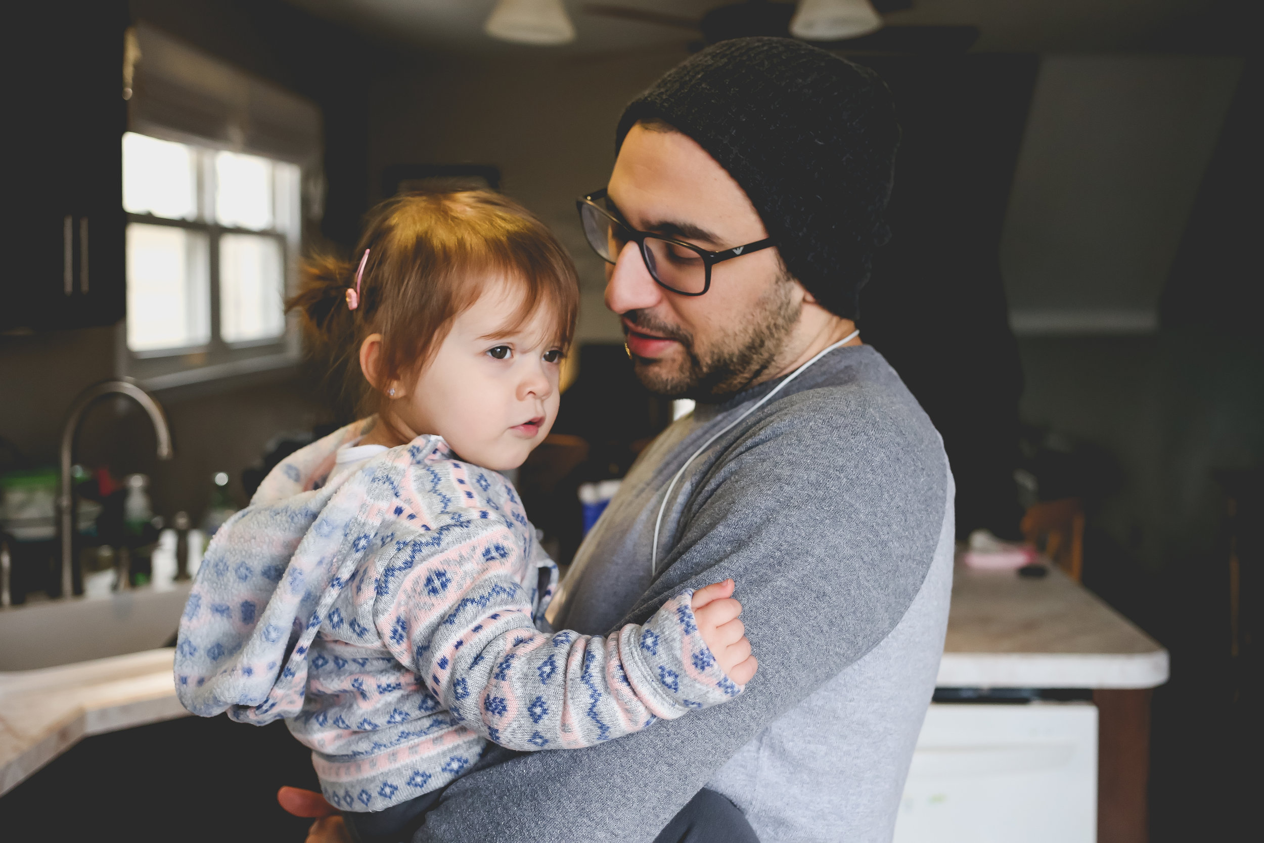 Father and daughter in their kitchen. At home family photography sessions by Jen Grima, Lehigh Valley Family Photographer.