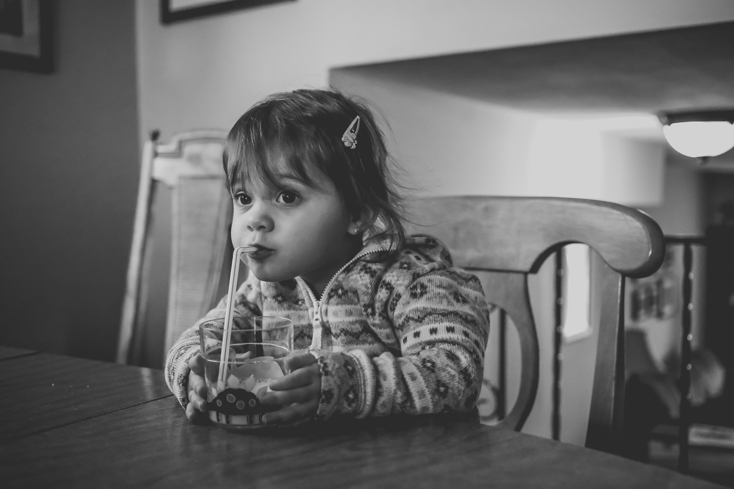 Toddler girl drinking milk, candid storytelling photography by Jen Grima, Macungie, PA.
