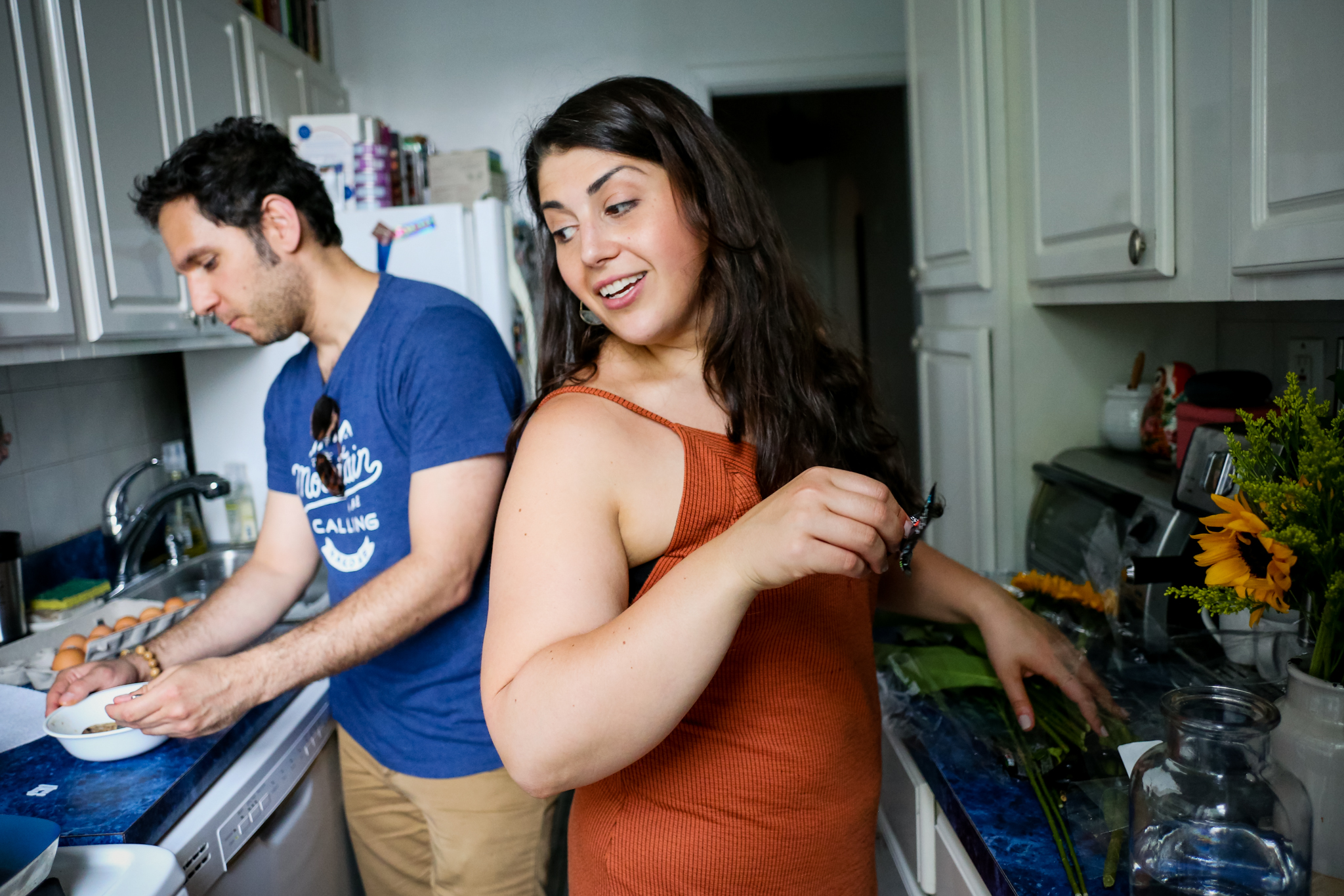 Cooking at home together during an engagement photo shoot with Jen Grima, Lehigh Valley Family Photographer.