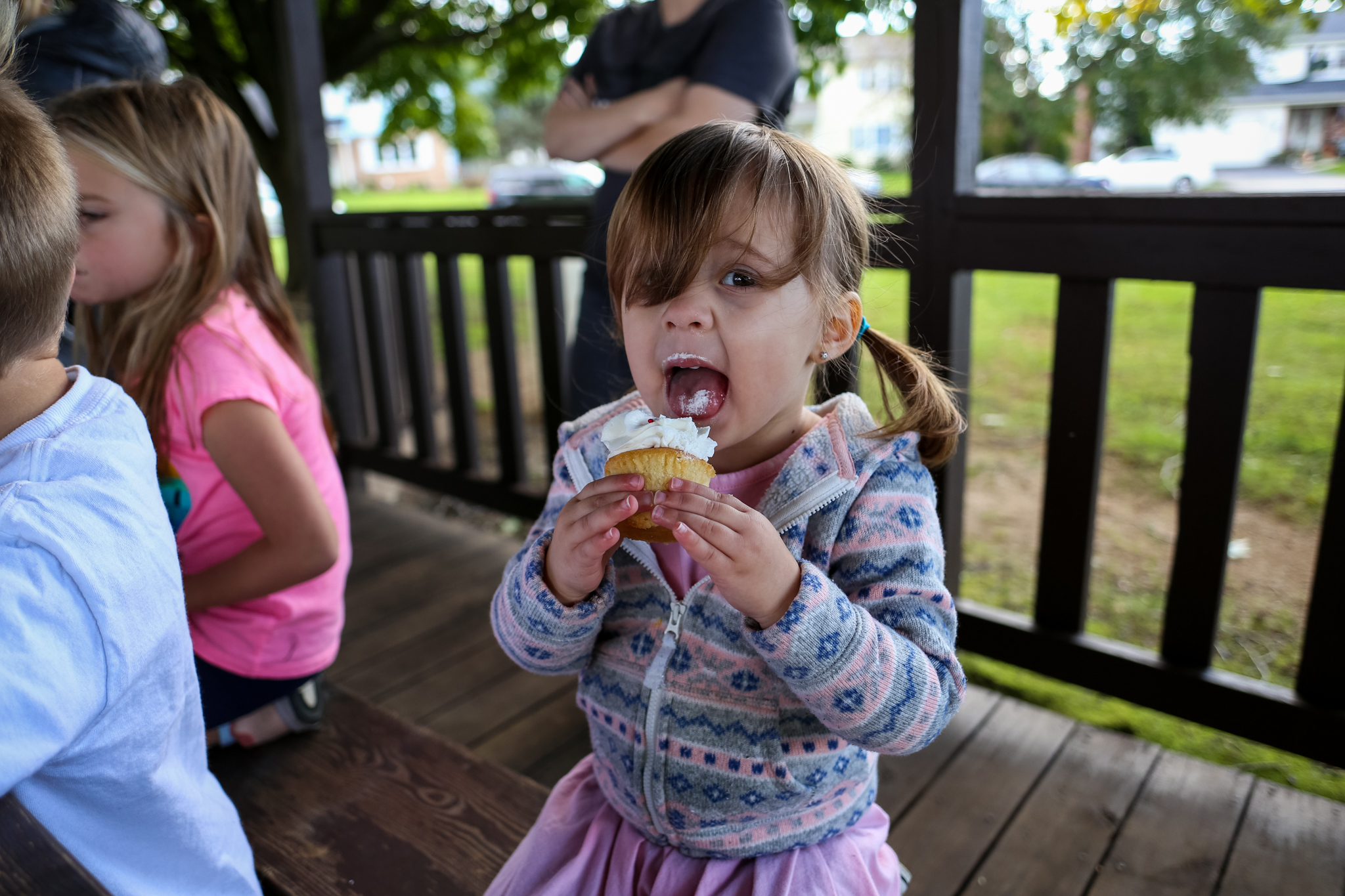 Little girl enjoying a cupcake at an outdoor birthday party in Macungie, PA.