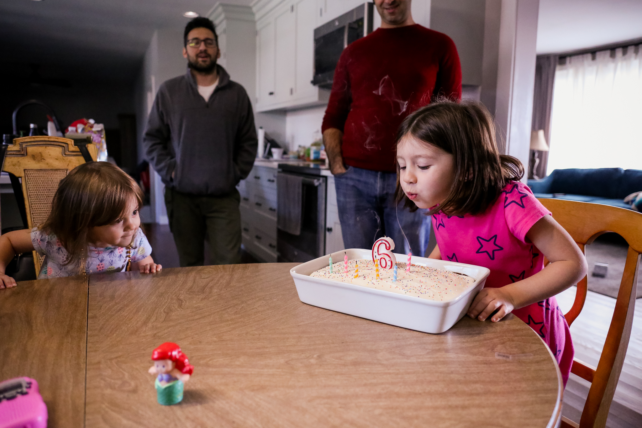 Blowing out the candles on her birthday cake! An at home party in Macungie, PA.