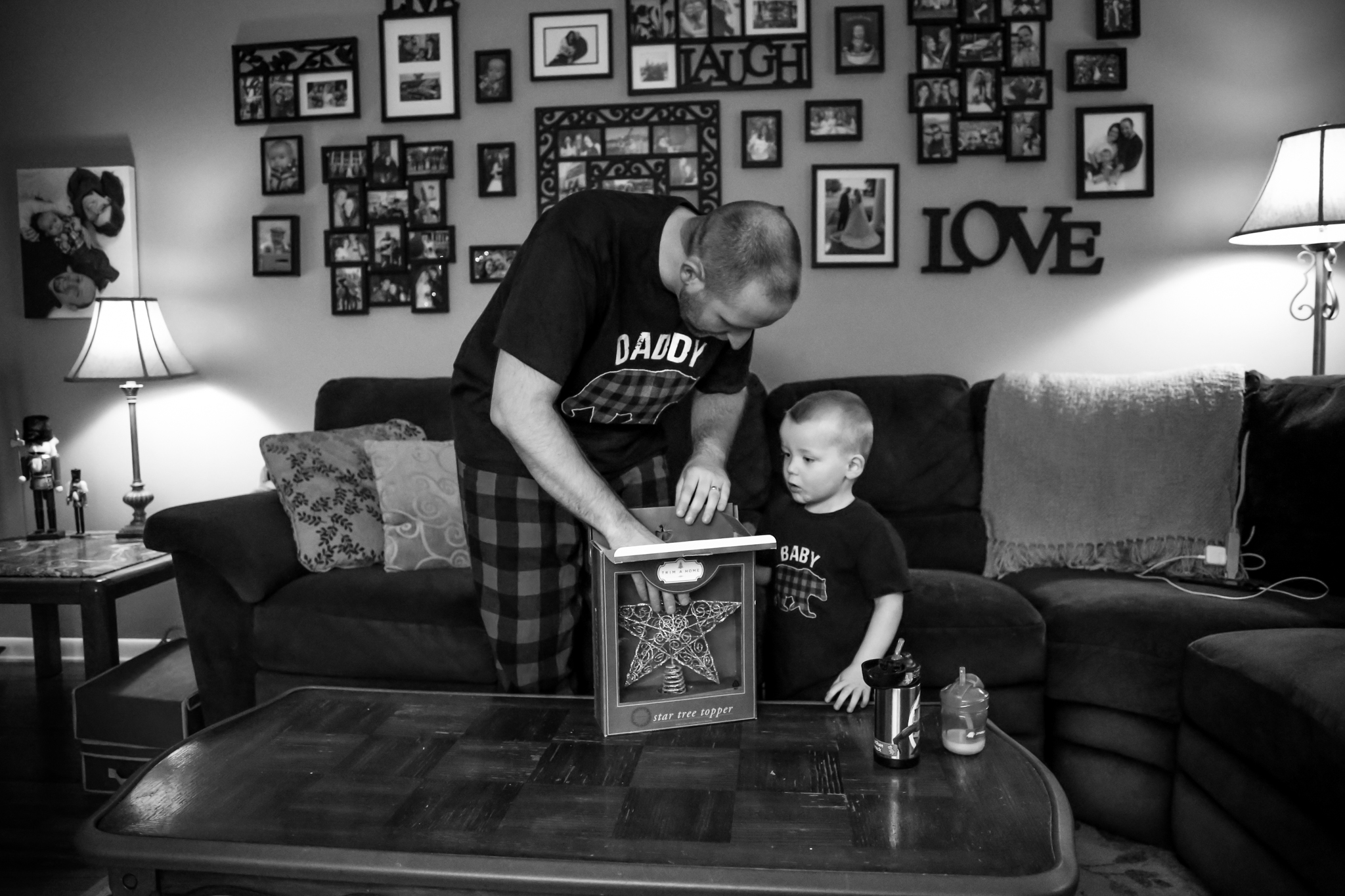 Father and son, getting the star ready for their Christmas tree at their home in Lehigh Valley, Pennsylvania.