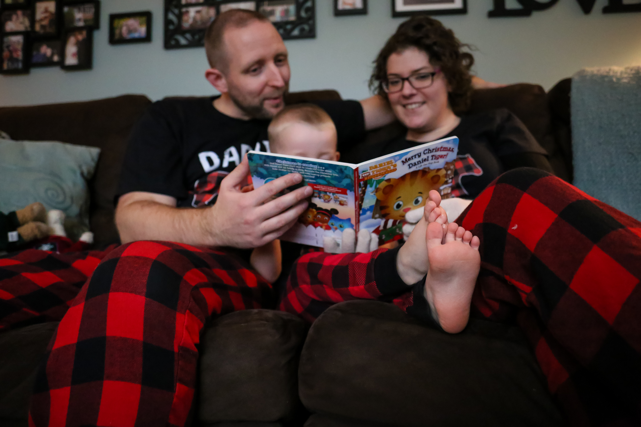 Documenting holiday traditions - a young family reads a Christmas story together in their Emmaus, PA home.
