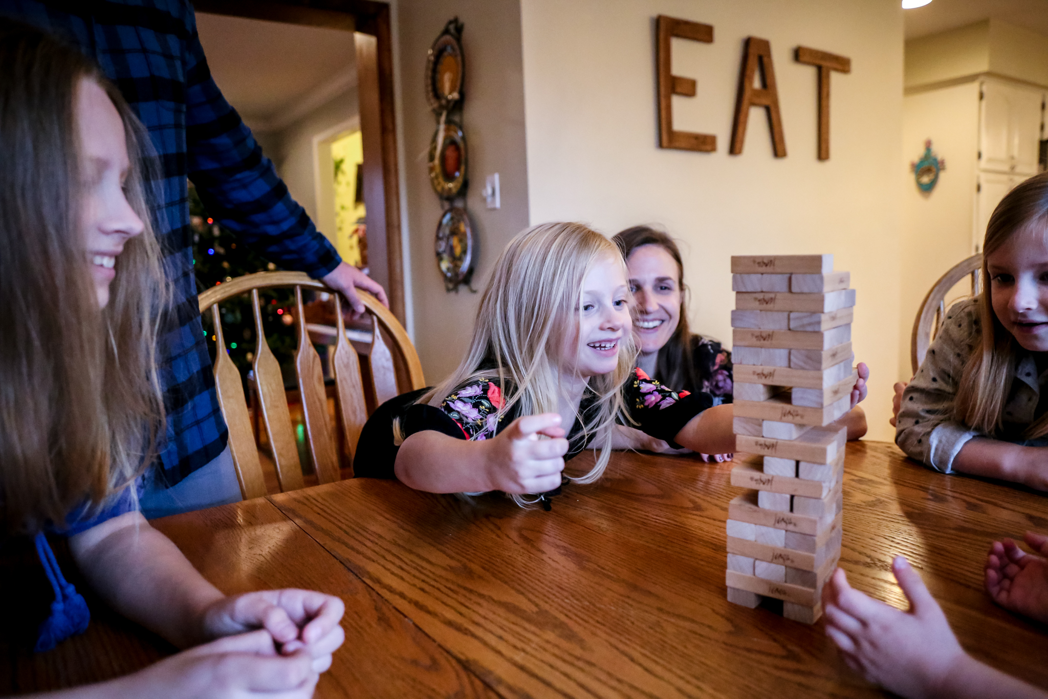 Family playing Jenga together during an in-home documentary session with Jen Grima, a family photographer from Lehigh Valley, PA.