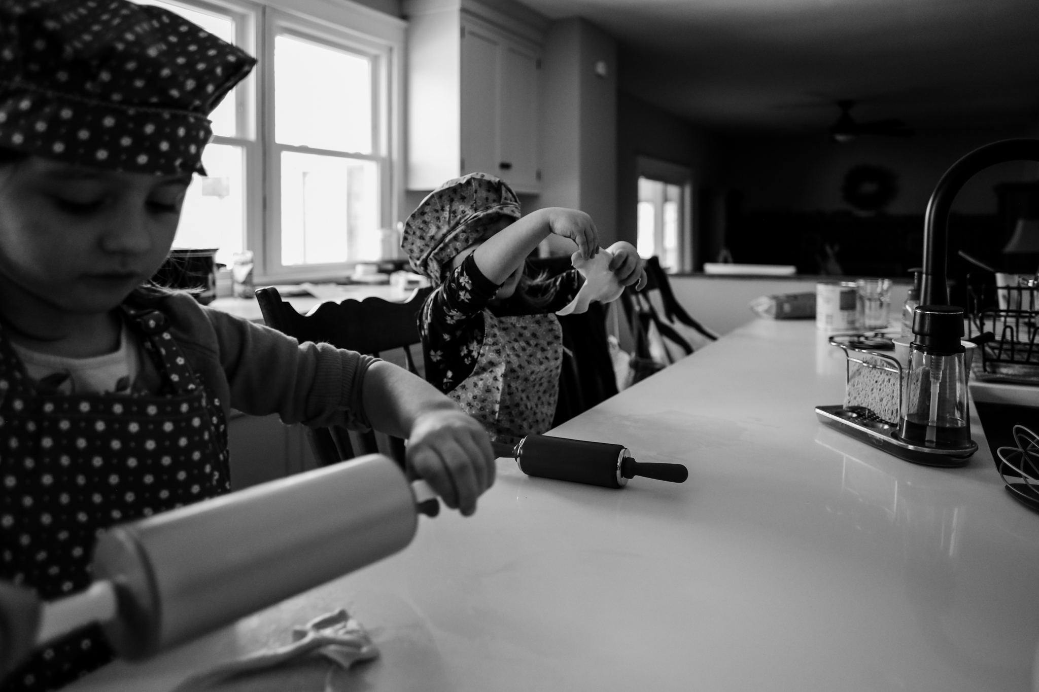 Little girls baking at home during a family photography session in Macungie, PA.