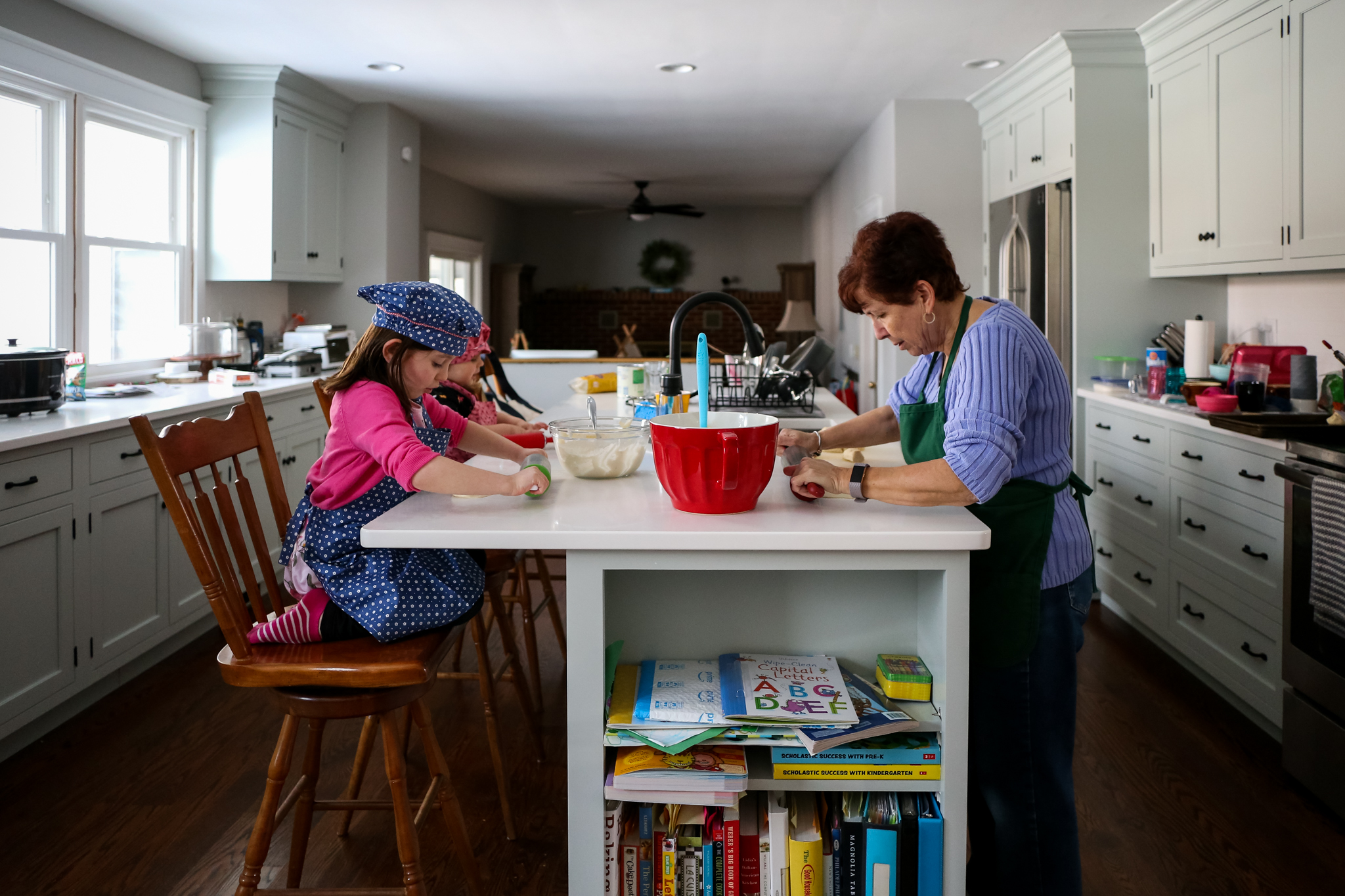 Little girls baking with grandma during an at home family photography session in Lehigh Valley, PA.
