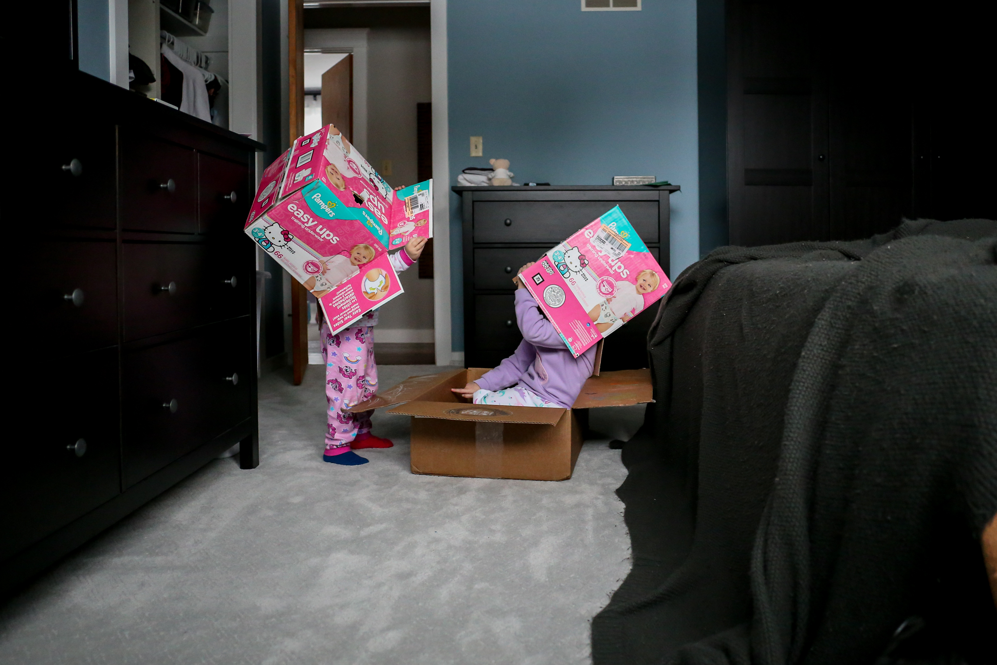 Playing with cardboard boxes during an at-home family photo session in Macungie, PA.