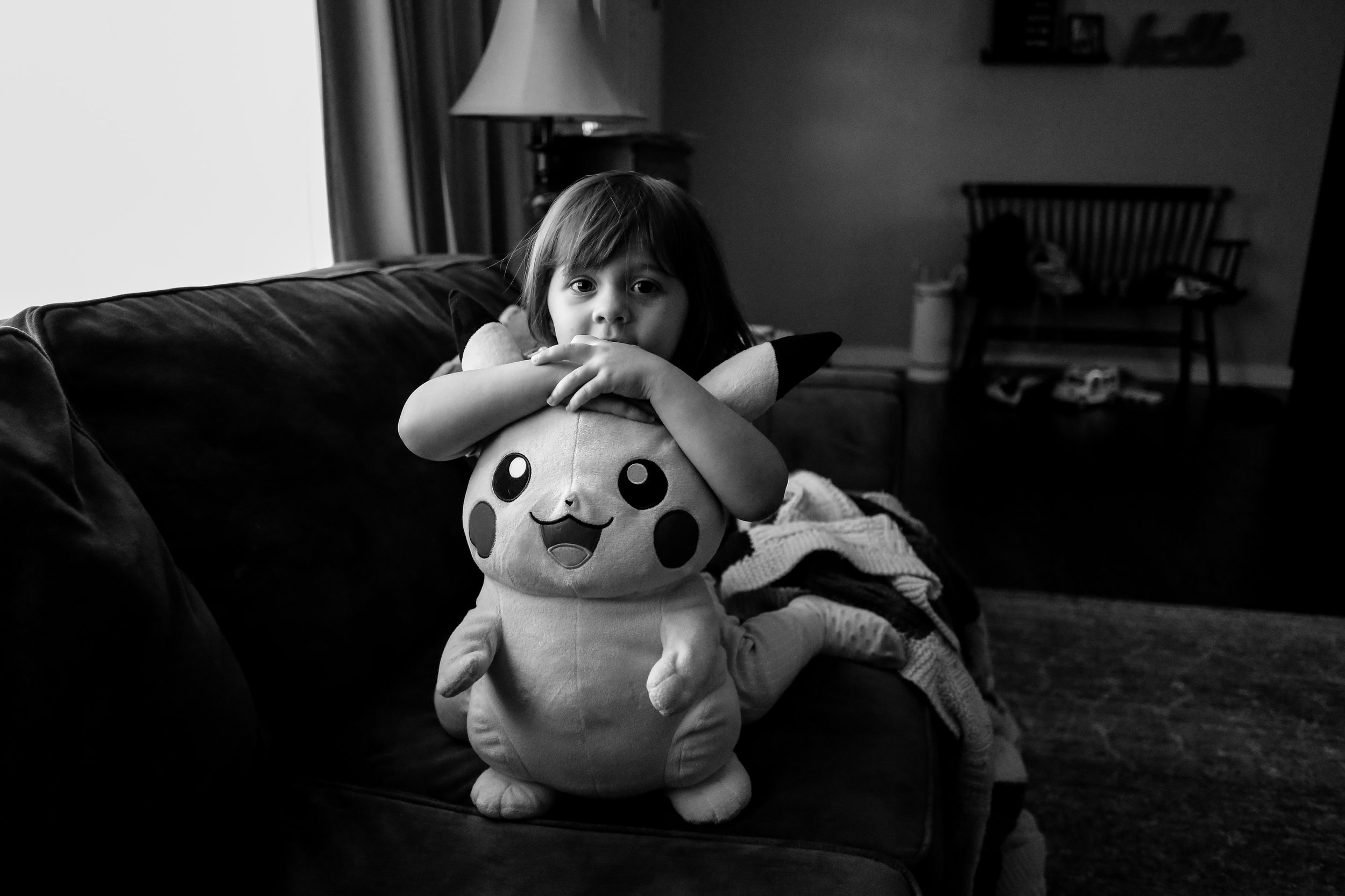 A girl with her favorite Pokemon toy during an at home family photography session in Macungie, PA.