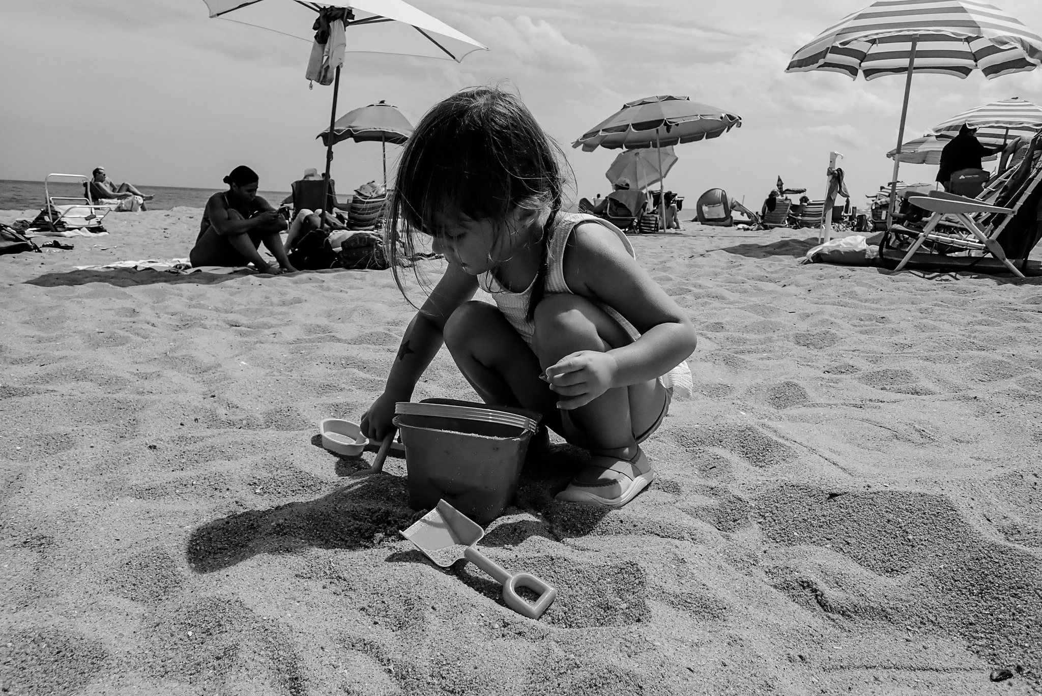 Toddler playing in the sand at the beach during a family vacation in Asbury Park, NJ.