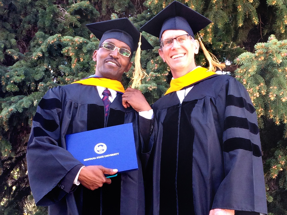 Montana State University graduate student Dr. Wigganson Matandiko (L) poses with his newly-minted Ph.D. and his academic advisor Dr. Scott Creel.