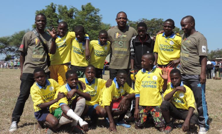 Zambian Football Legend Kalusha Bwayla (center) poses with the Mimbulu Boys Academy at the Carnivore Cup/Fun Run