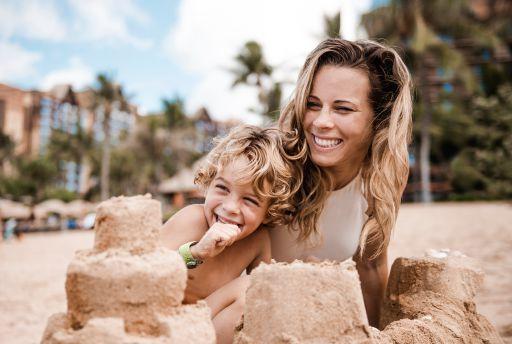 Mom and Son at Aulani beach