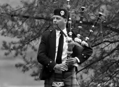 Michael Lancaster, bagpiper at the House of Piping