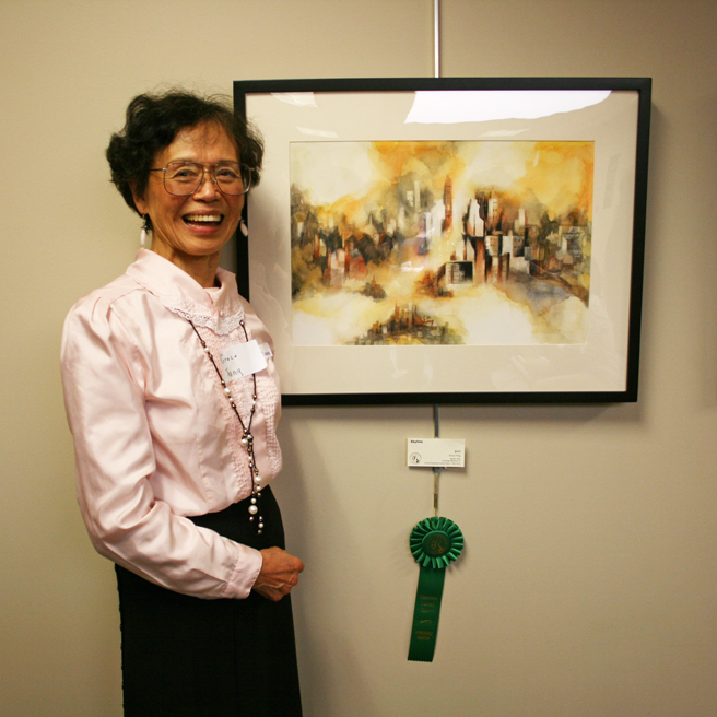 Grace Tang with her watercolor  Skyline  for which she won an Honorable Mention in Wet Media at the LGAA Fall Juried Show in 2012.