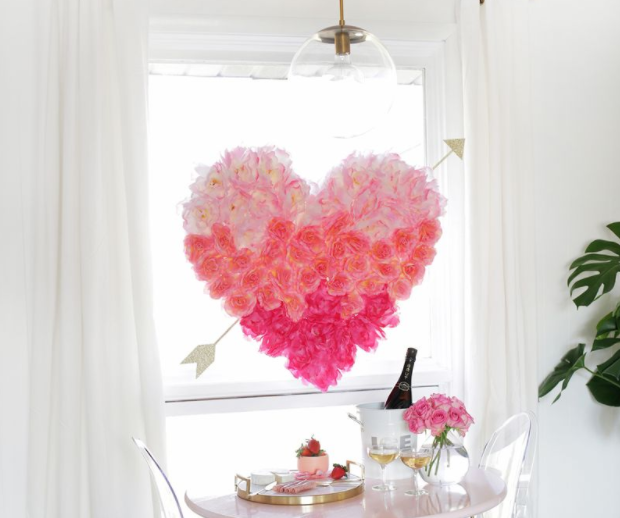 FLOWER HEART & ARROW - Source: A Beautiful Mess This DIY should be at the top of your list for your next interior home shoot. A perfect DIY for a backdrop to an intimate Valentine's Day dinner, or for hanging over the couch for a romantic evening in. Using inexpensive faux flowers from a dollar store, this is an easy-to-do DIY with huge visual impact.