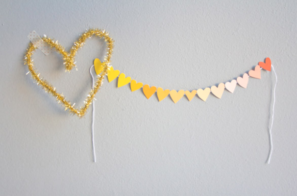paint chip heart garland - Source: Lovely IndeedSuper simple DIY project for any backdrop photograph, and nearly free to create! Pick any colour that matches the brief theme, go by your local hardware shop, and you're good to go!