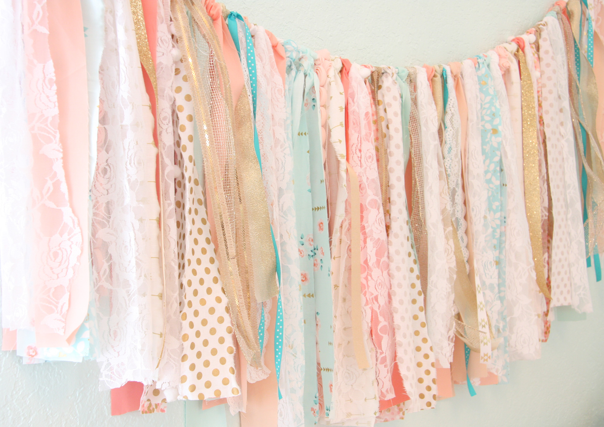 Fabric Garland - This is a perfect way to get rid of any excess crafting fabric you have around, or to pop by your local fabric shop and see if they have any excess material hanging around. Not only does this backdrop bring texture to your photographs, it looks great and is inexpensive to create. Check out this blog post for inspiration.Photo: Project Nursery