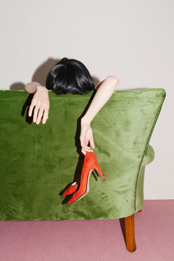 woman behind green couch with red heels.jpg