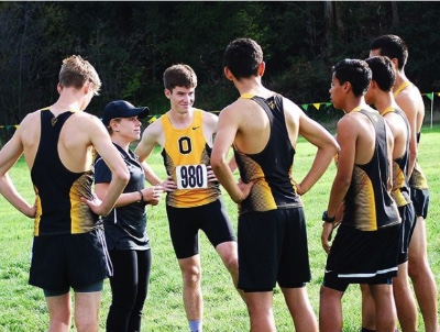 Kigar with the Bishop O'Dowd Cross Country team