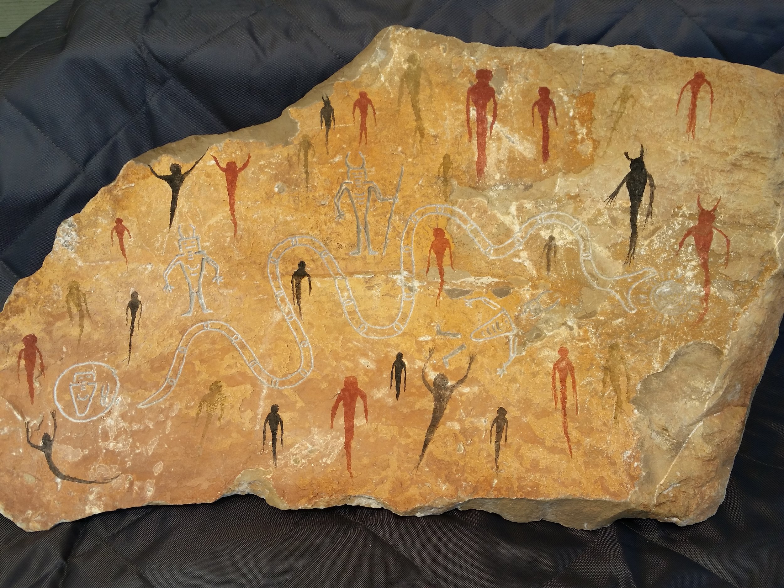 FOURTH DAY VISION, Carved Teton metamorphic rock table piece with red and yellow ochres and animal bone pigment. 60lbs. Aged, then weather treated. $200