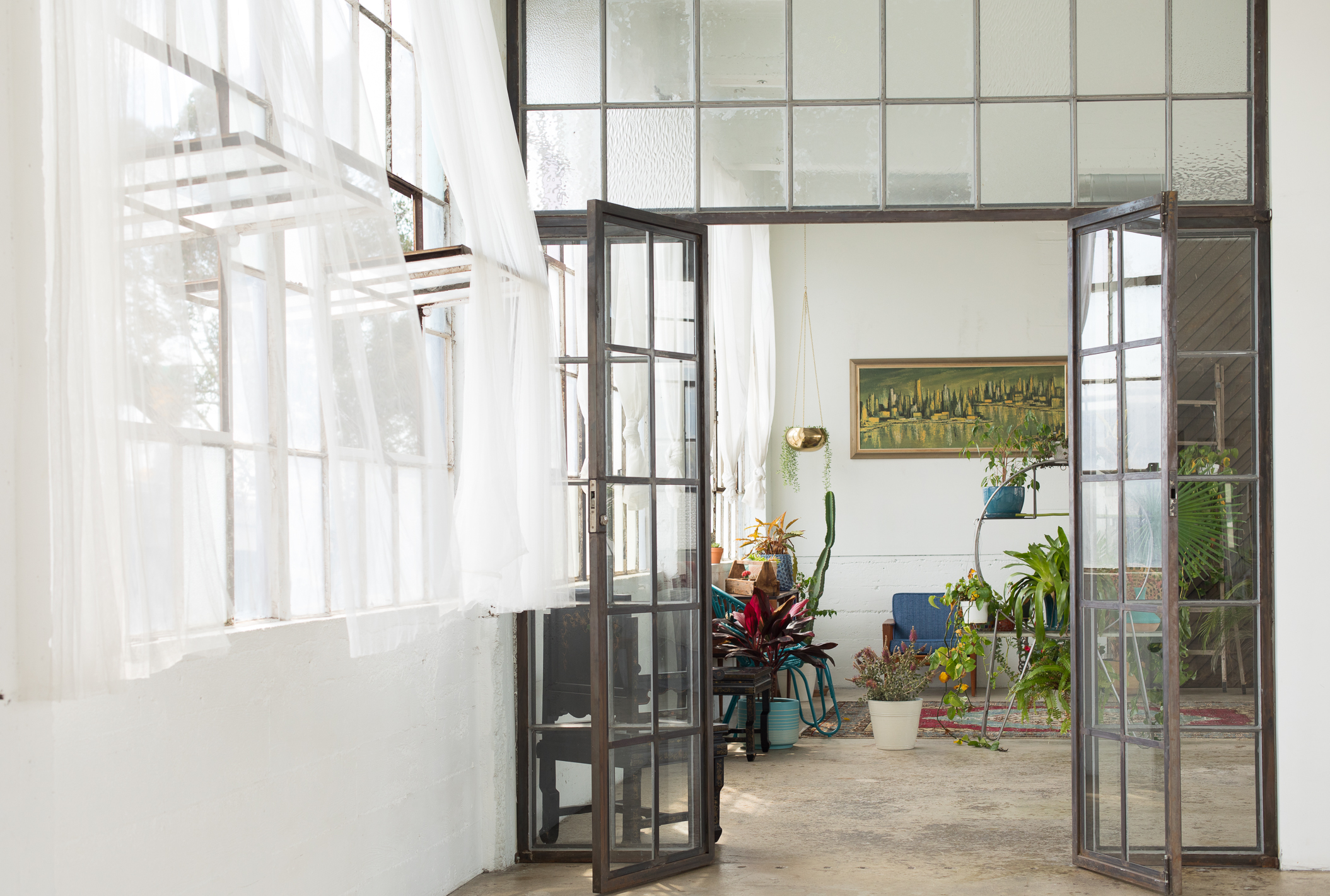 Lunette Loft - DTLAThis stunning, light drenched industrial loft space features both a beautifully Designed residential loft and a huge blank canvas corridor with high ceilings and entire walls of windows showing sweeping views of the downtown LA skyline.