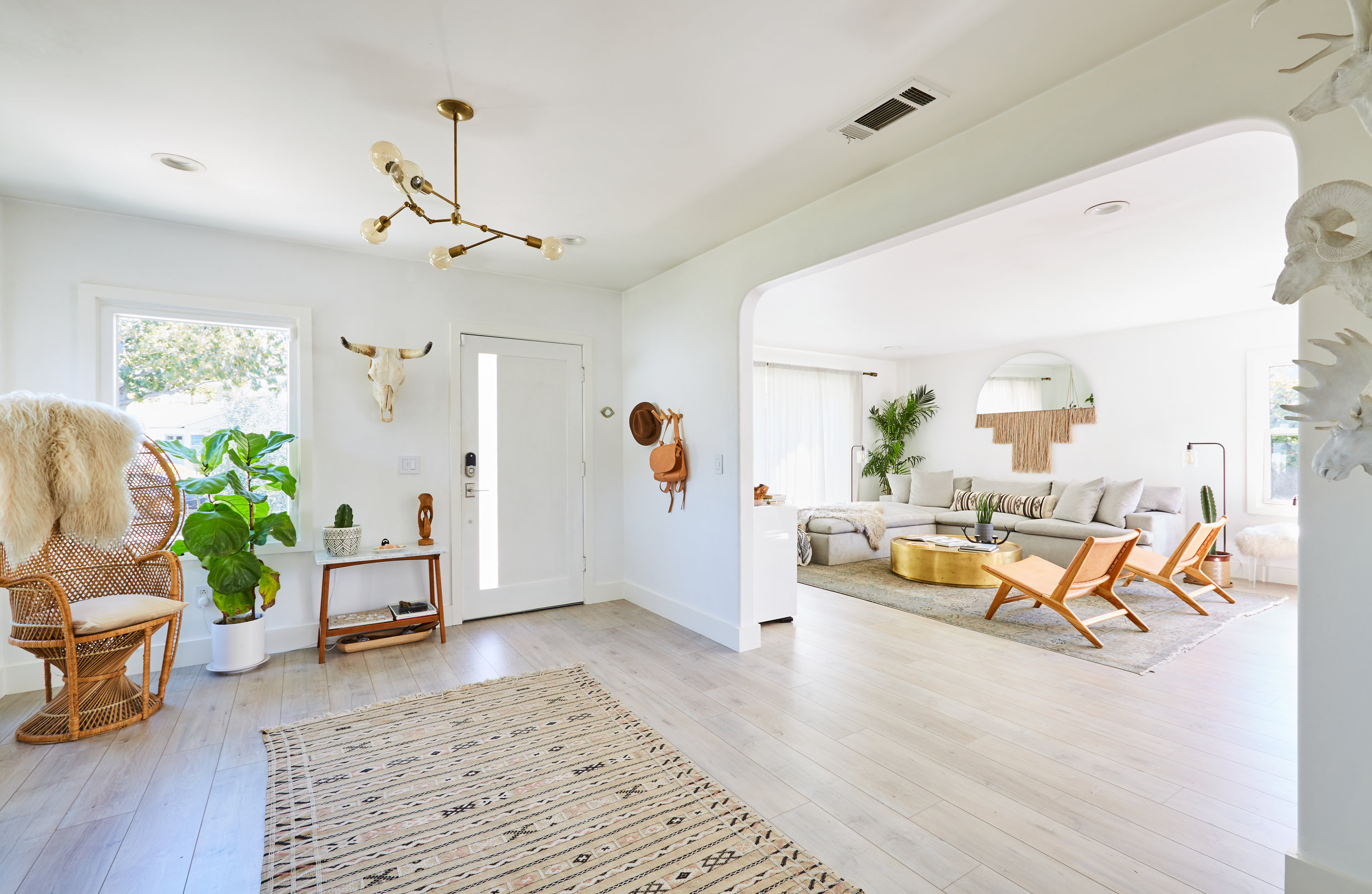 The Palm House - PalmsThis clean, cool, minimal mid century home is 2,500 square feet of modern charm, clean lines, cozy textures, & organic-modern decor.