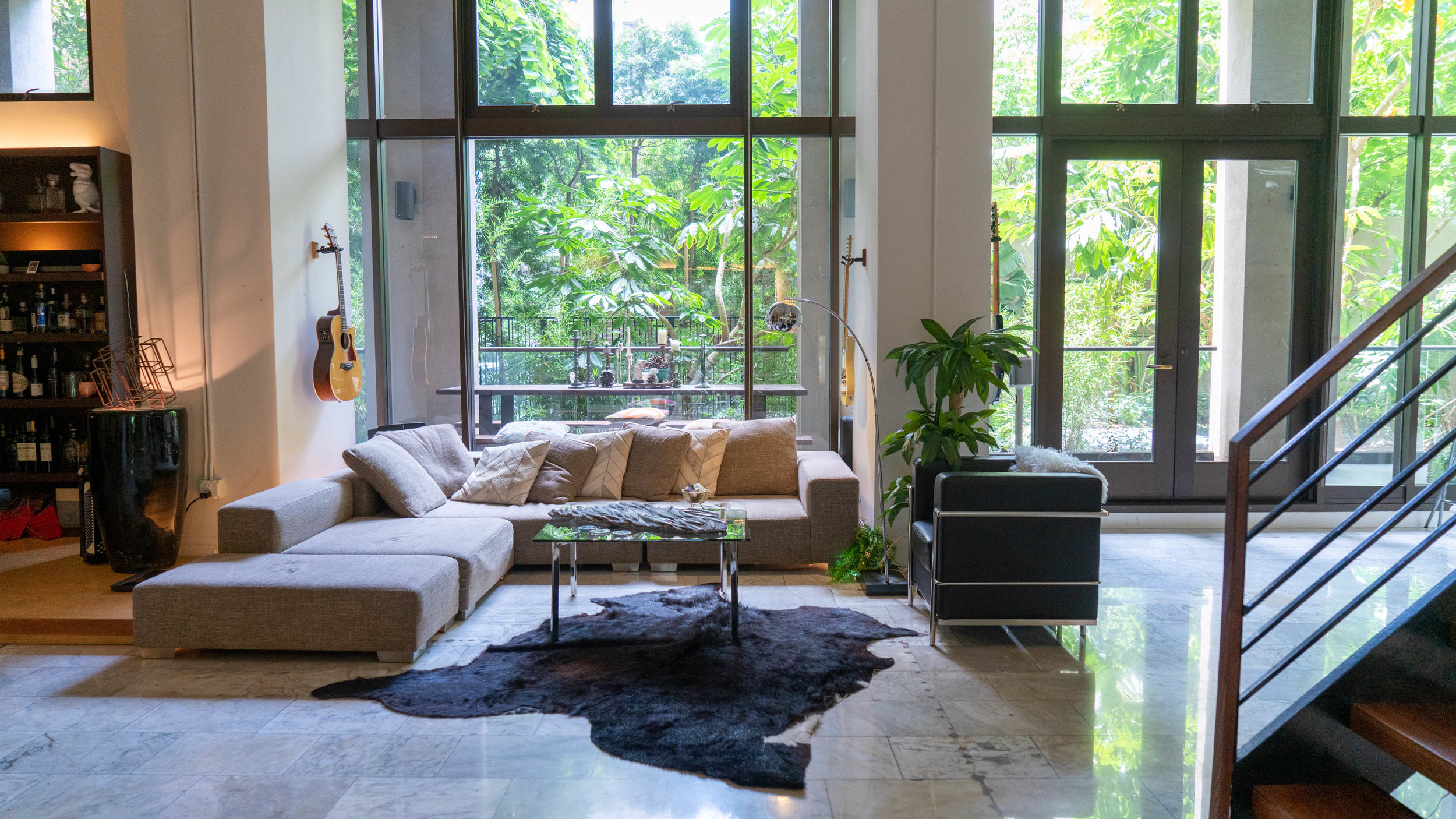 Downtown Sanctuary - DTLAA 2,000 sf ground floor loft in a film-friendly building with a private patio and tropical garden view.