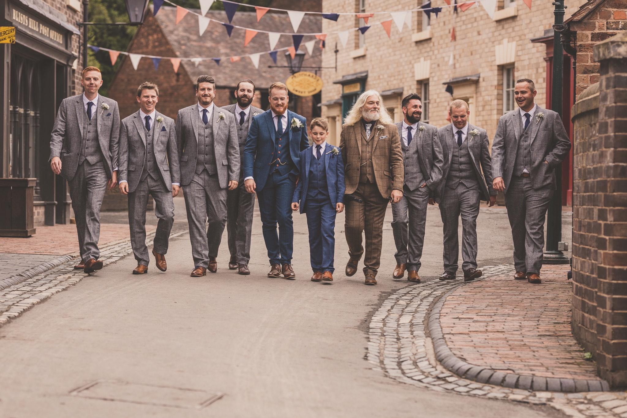 groom and groomsmen walking down a vintage street at Blists Hill Victorian Town, Ironbridge