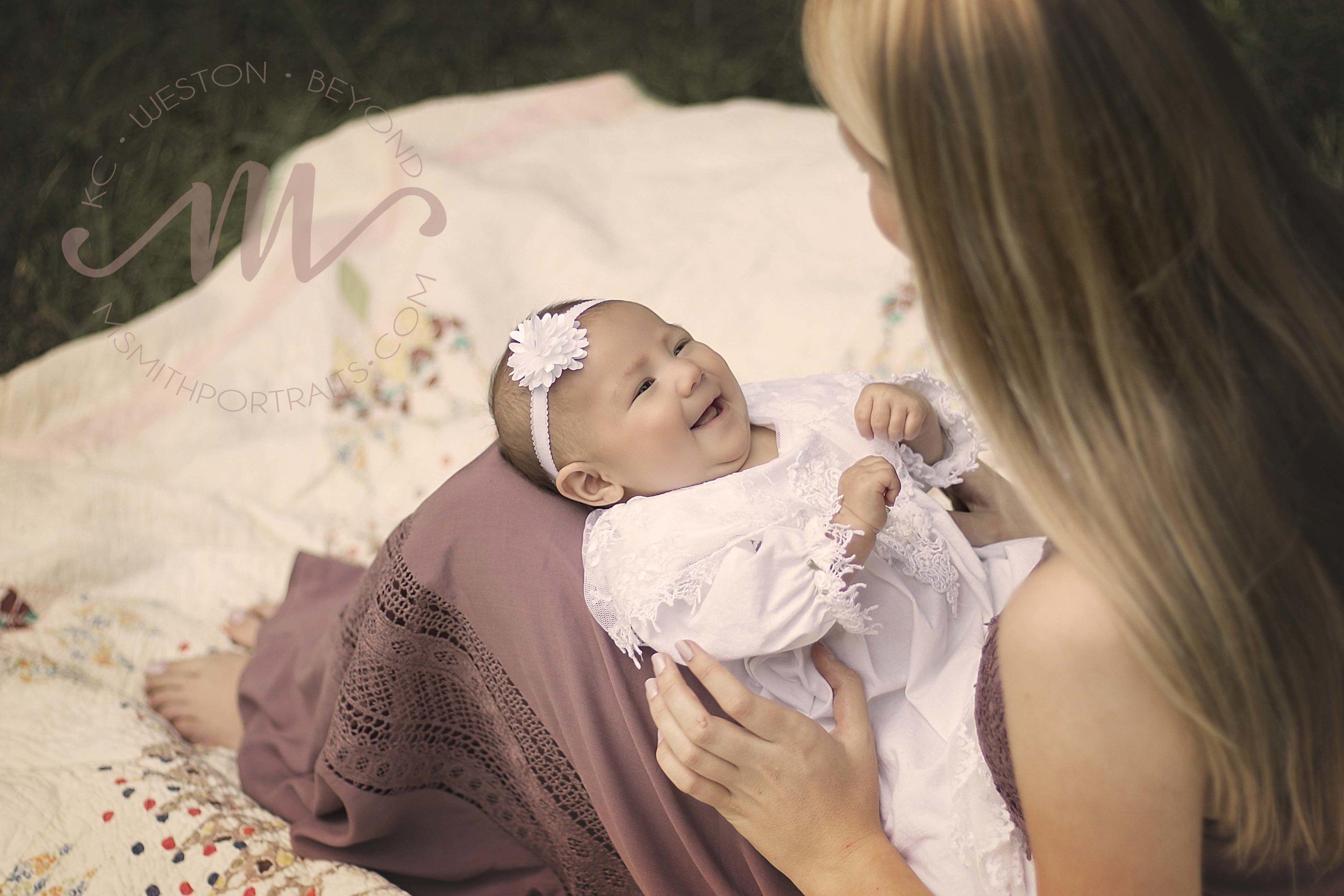 Baby girl smiling at mom