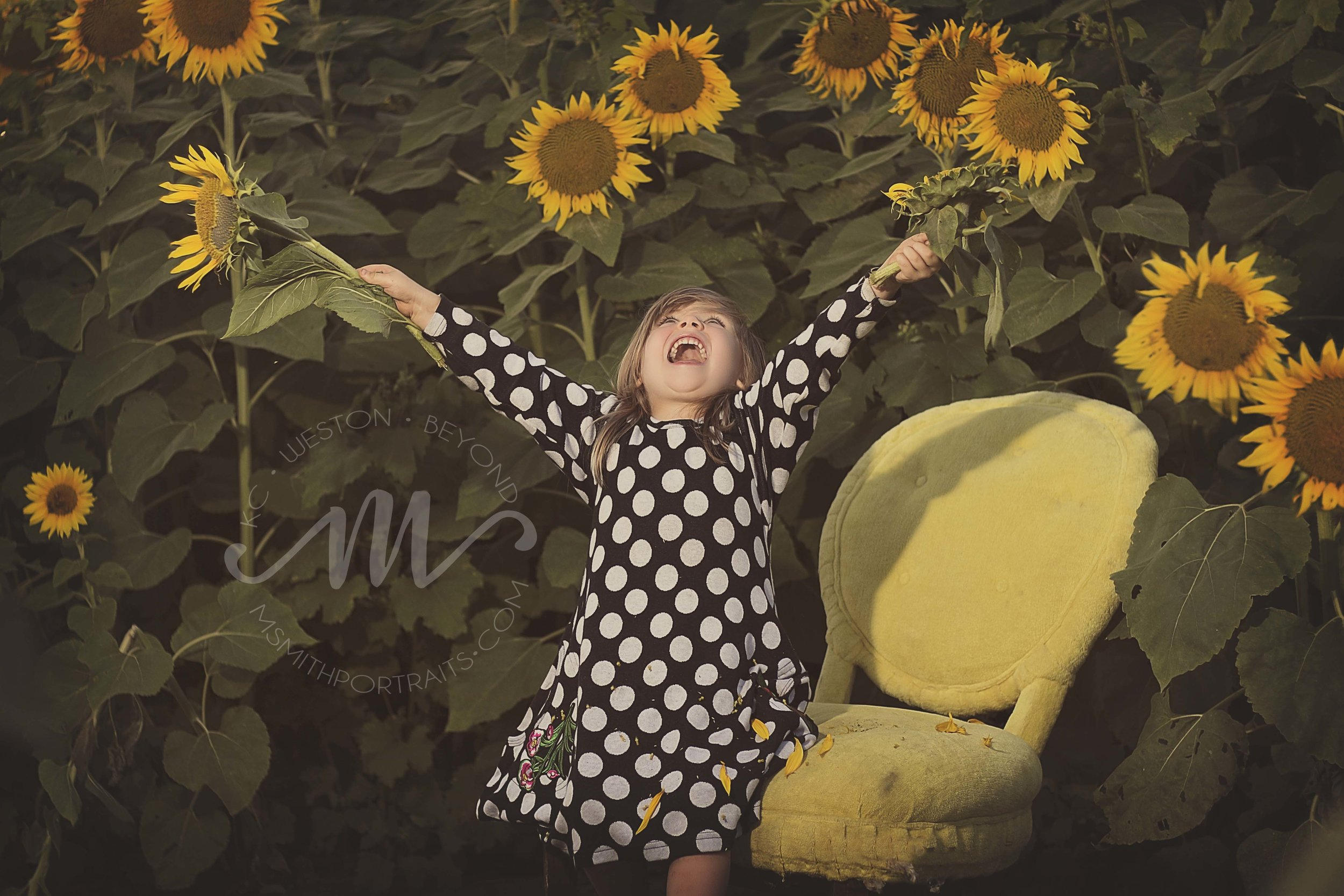 Girl Playing at Grinter Farms Sunflower Field