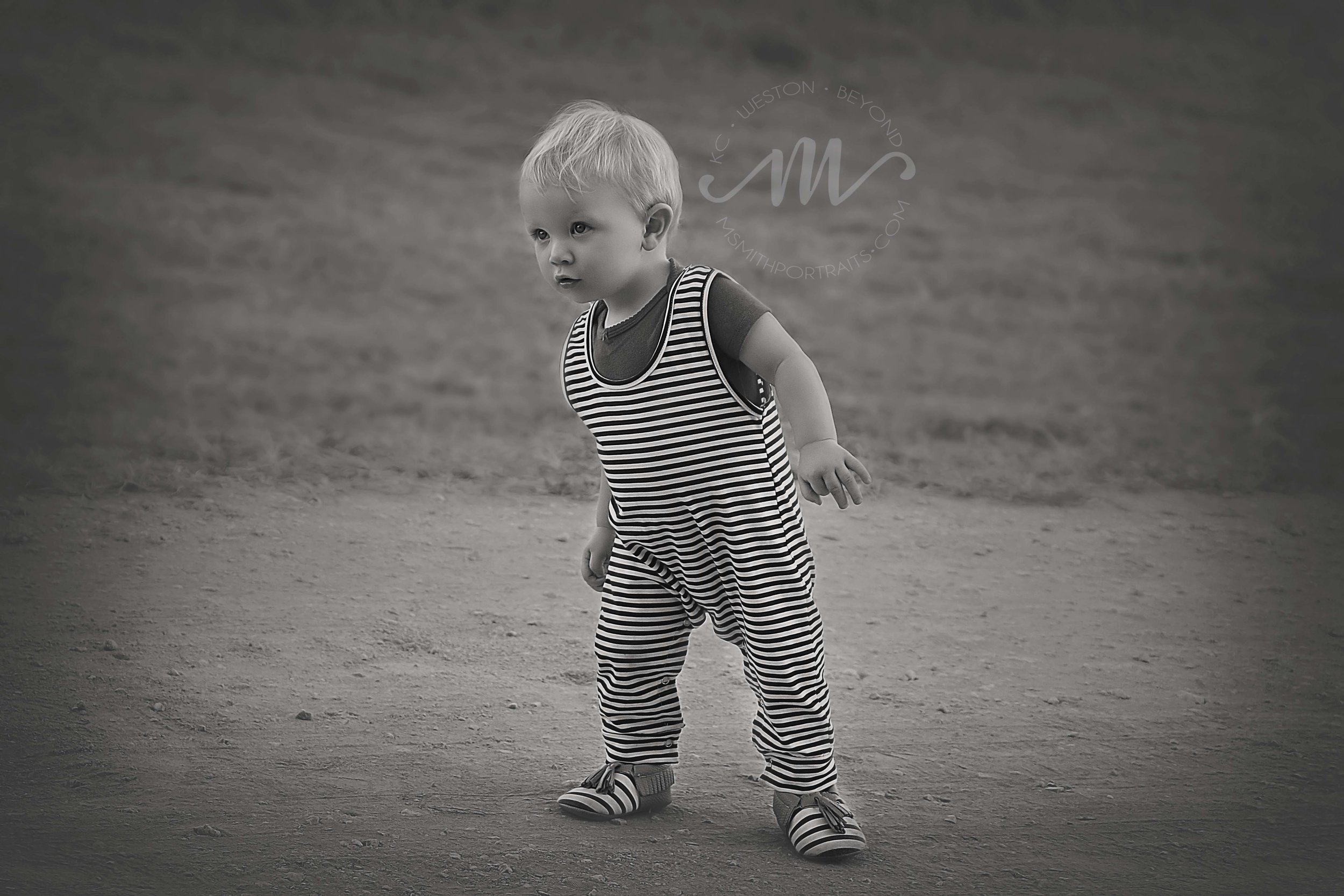 Baby boy walking photo