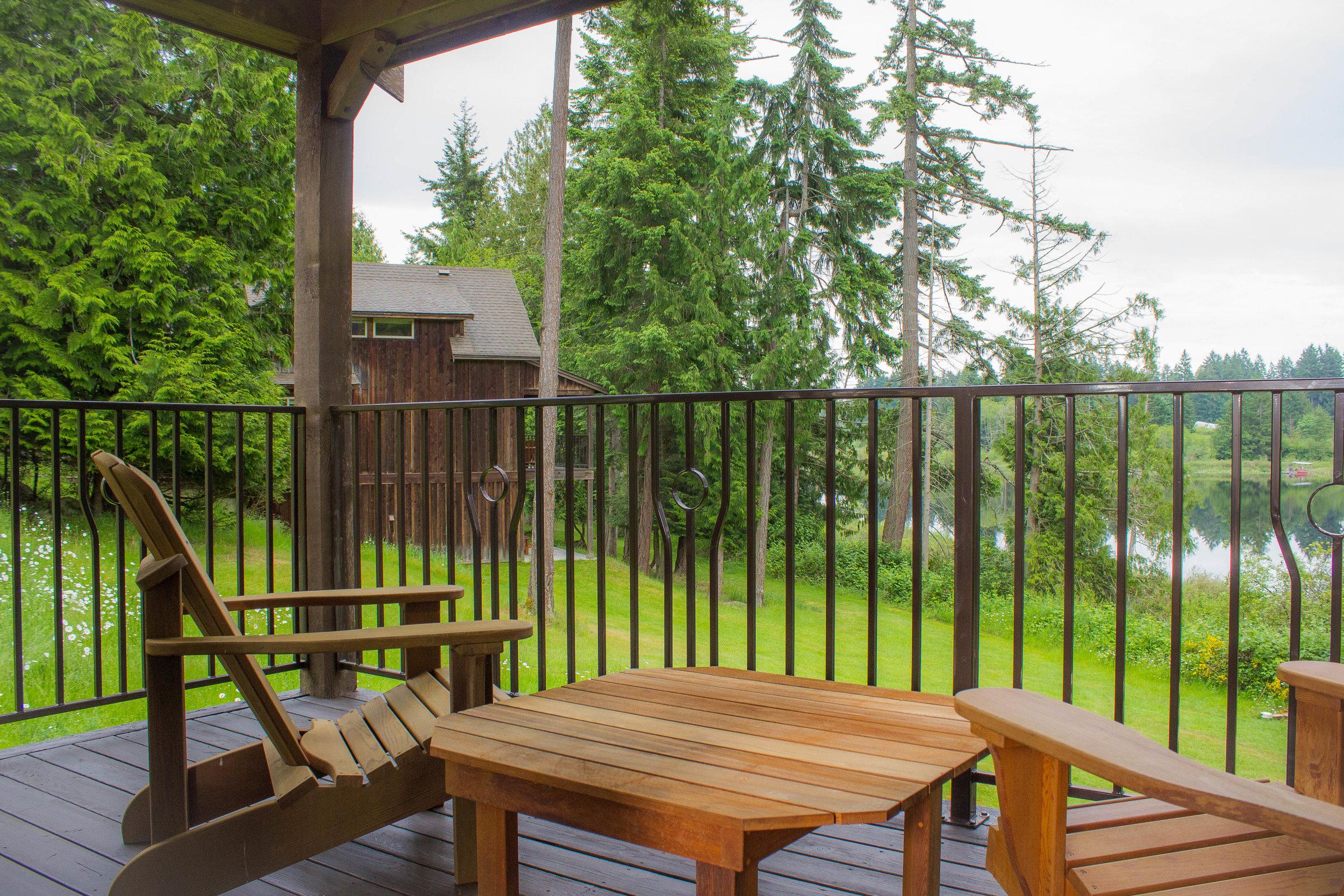 Cedar decks with custom metal railings and Adirondack chairs