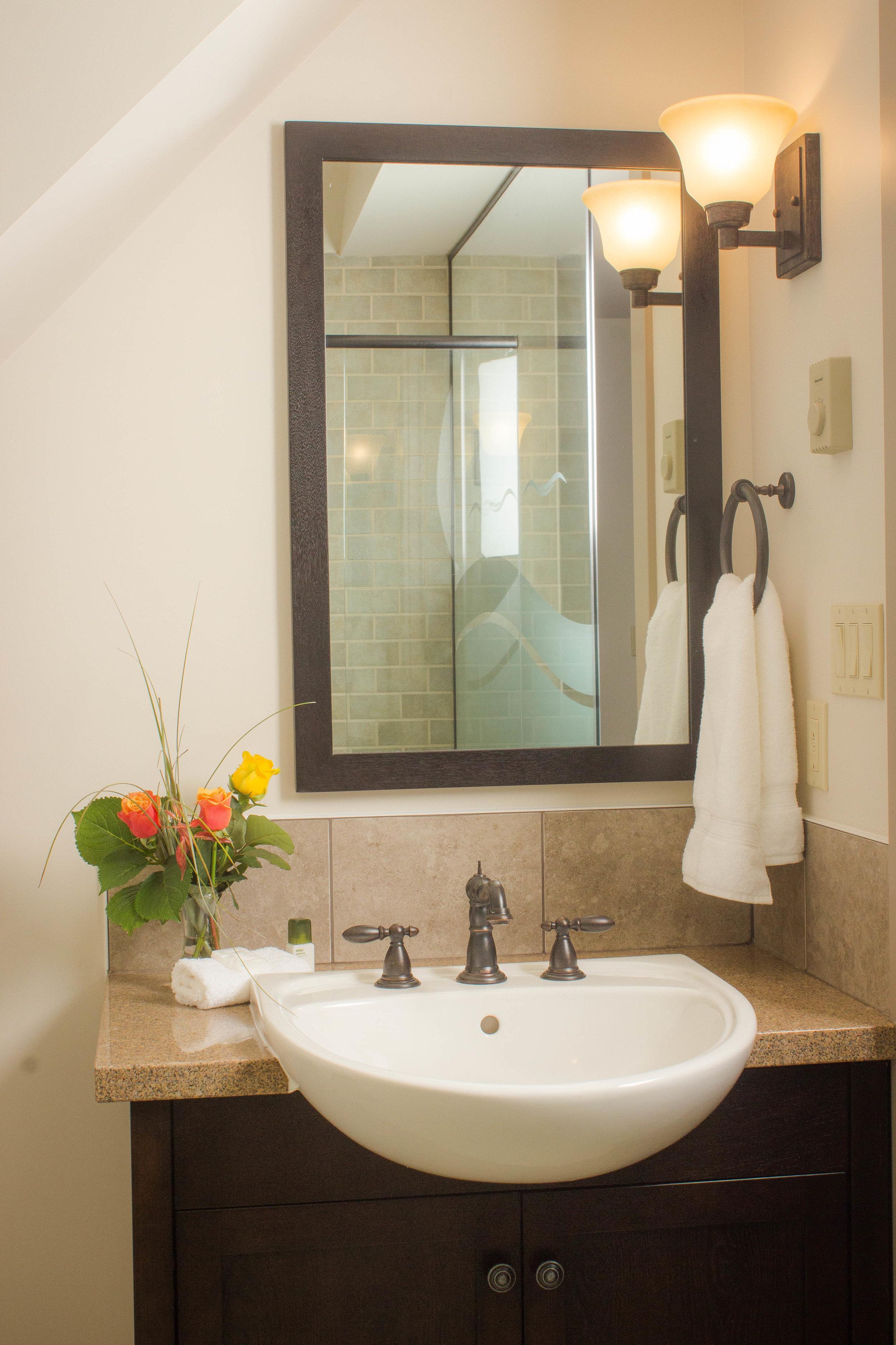 Quartz or granite countertops in all bathrooms and powder rooms