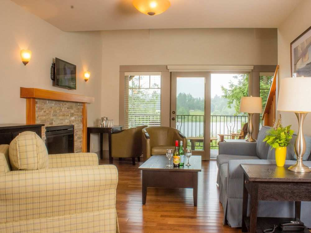 Main levels include new hotel quality furniture, laminated wood floors, electric fireplaces, and balconies overlooking the Bullock Lake.