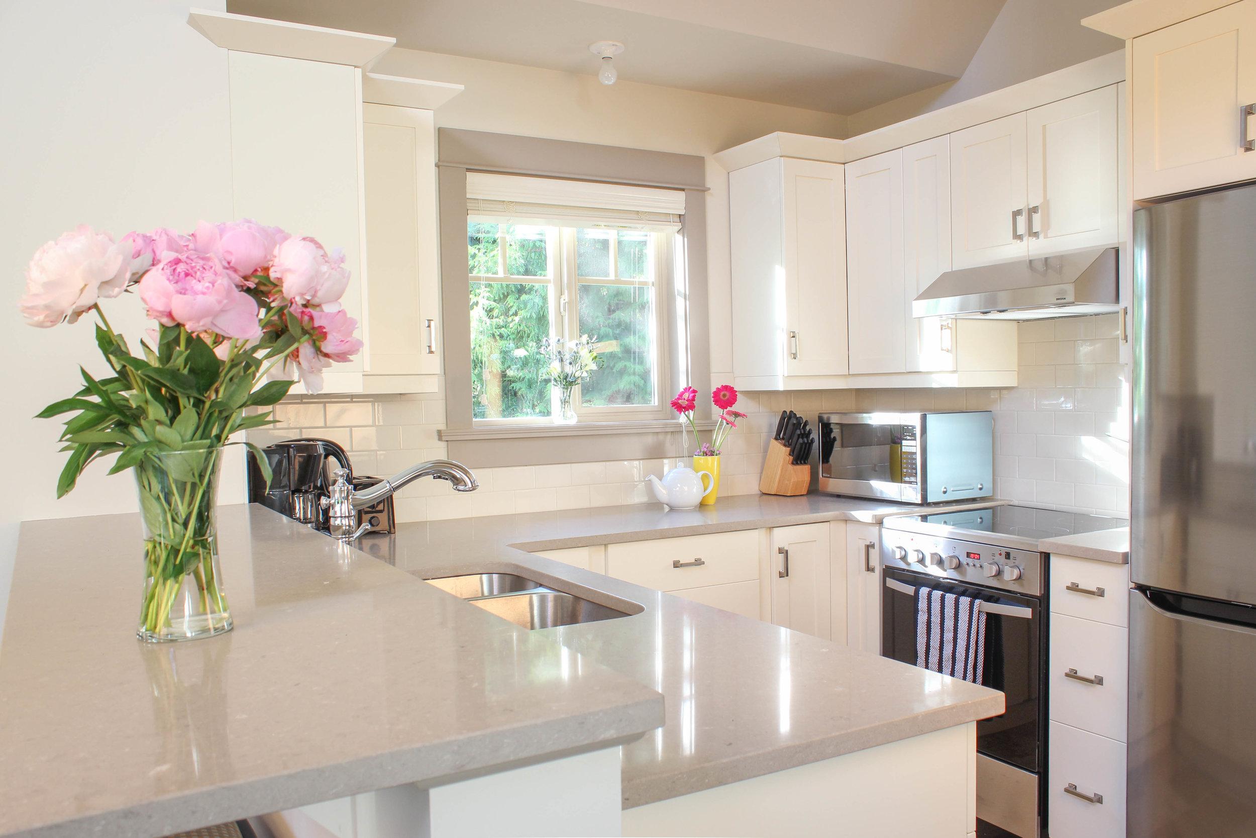 Quartz or granite countertops (cottage dependant) and tile backsplash