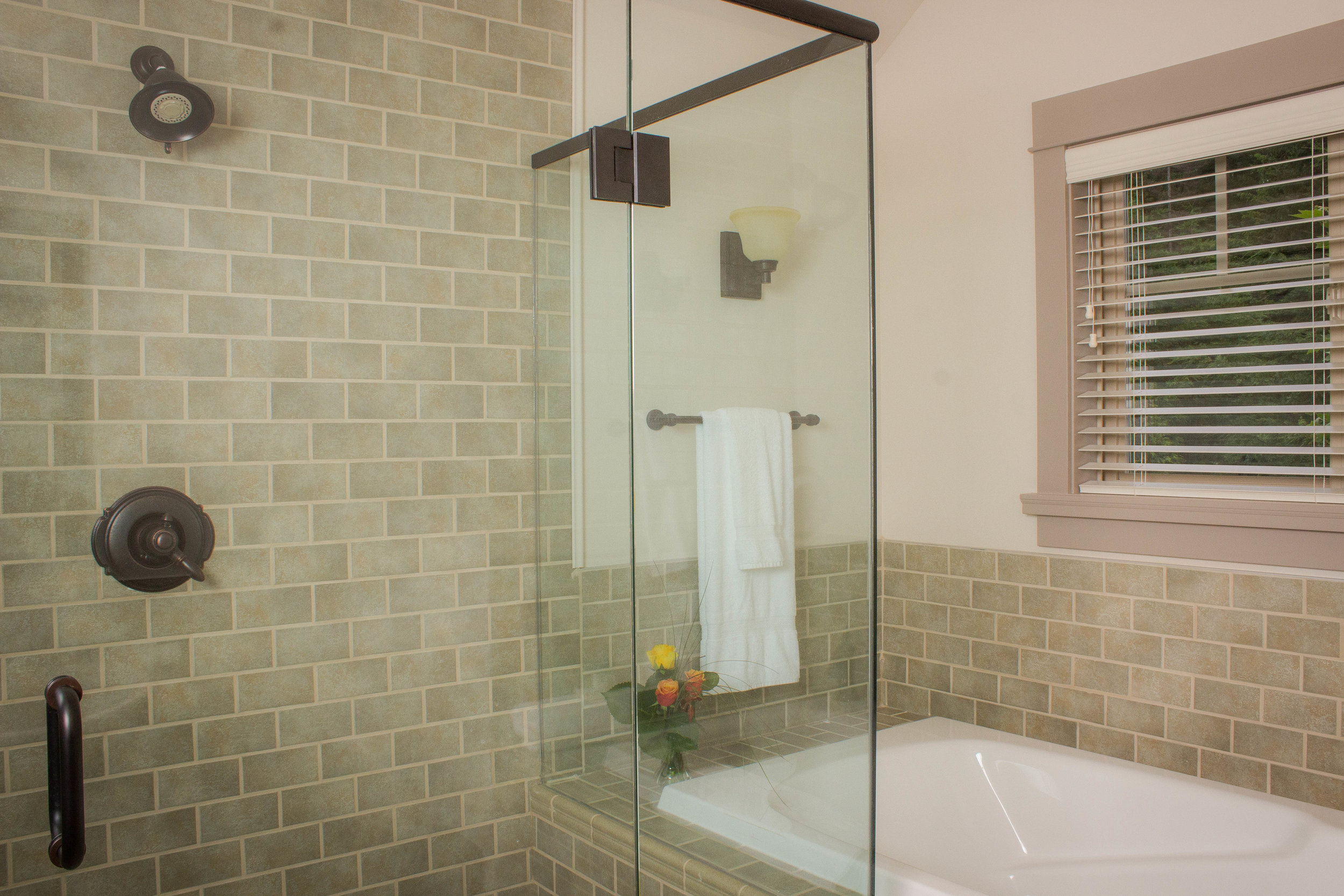 Cottages Features - Extensive glass shower enclosures in all bathrooms