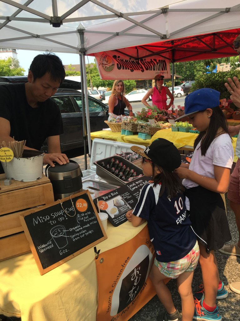 Sampling local food at the Tuesday Farmers Market.