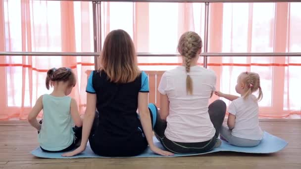 depositphotos_189608484-stock-video-family-yoga-gymnastics-window-two.jpg