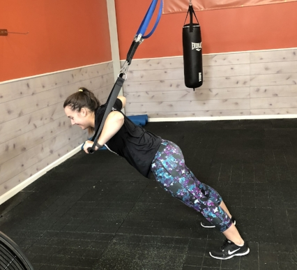 Exercise #2: Push Ups: Bring your arms out like you're superman! Don't let the straps of the TRX touch your wrists. Keep your butt down like you're in a plank and perform a push up as low as you can. Come back up to straight arms and repeat  Complete 12 reps