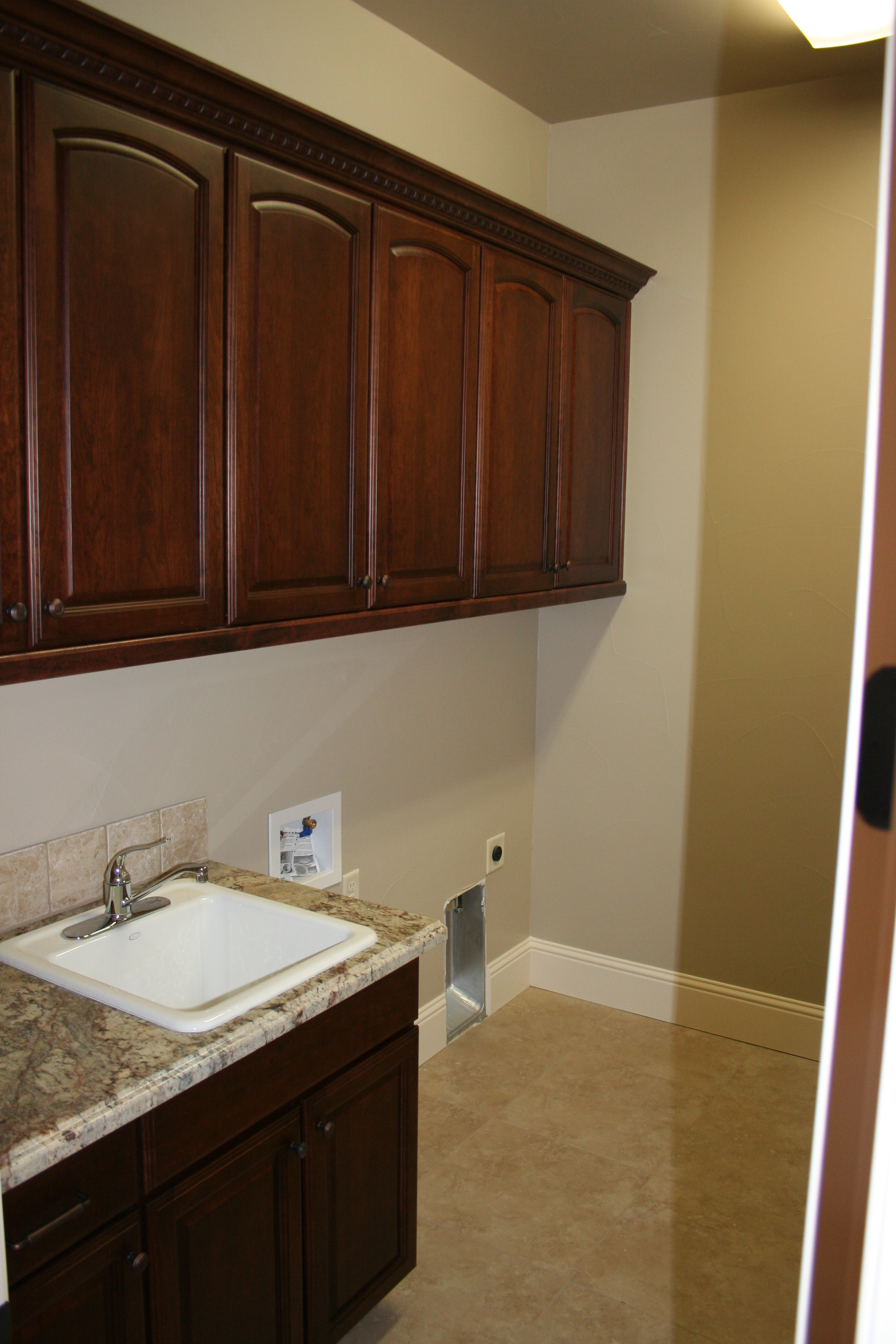 laundry room, sink, cabinets.JPG