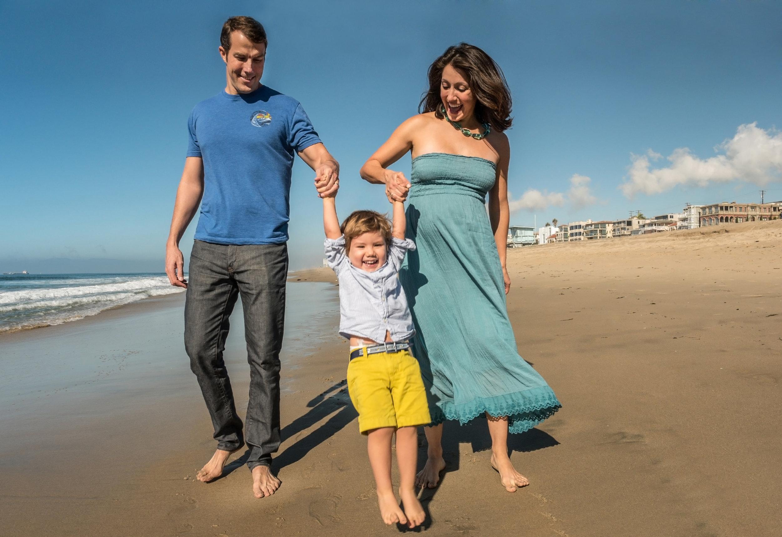 Family of three having fun at the beach