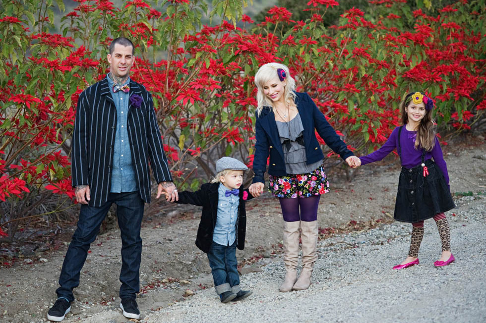 Family of four holding hands wearing hip outfits