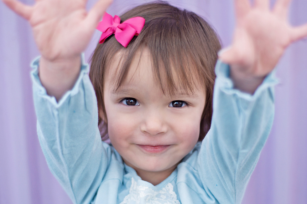 Little girl raising her arms asking to be held