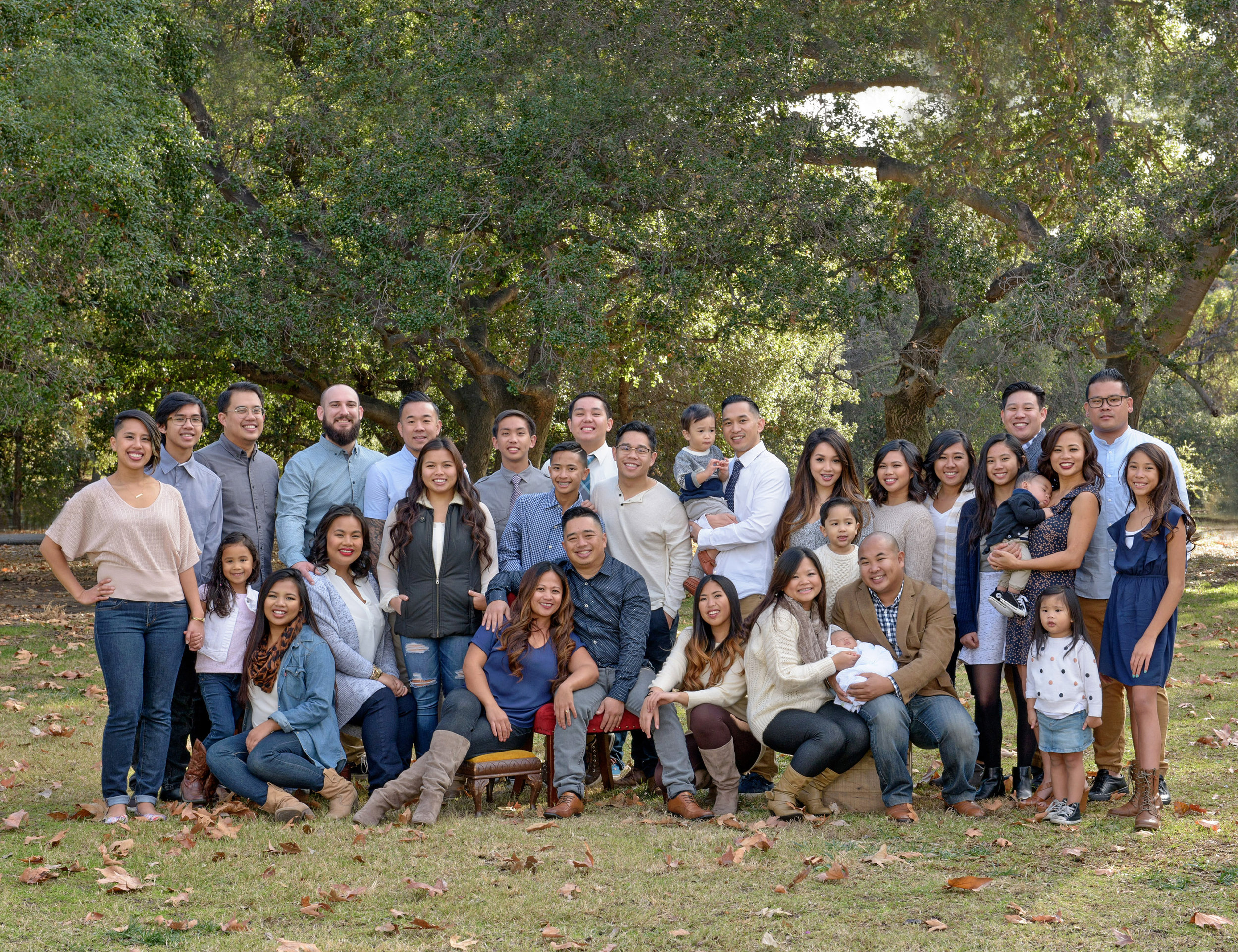 A large gathering of cousins posing for a family photograph