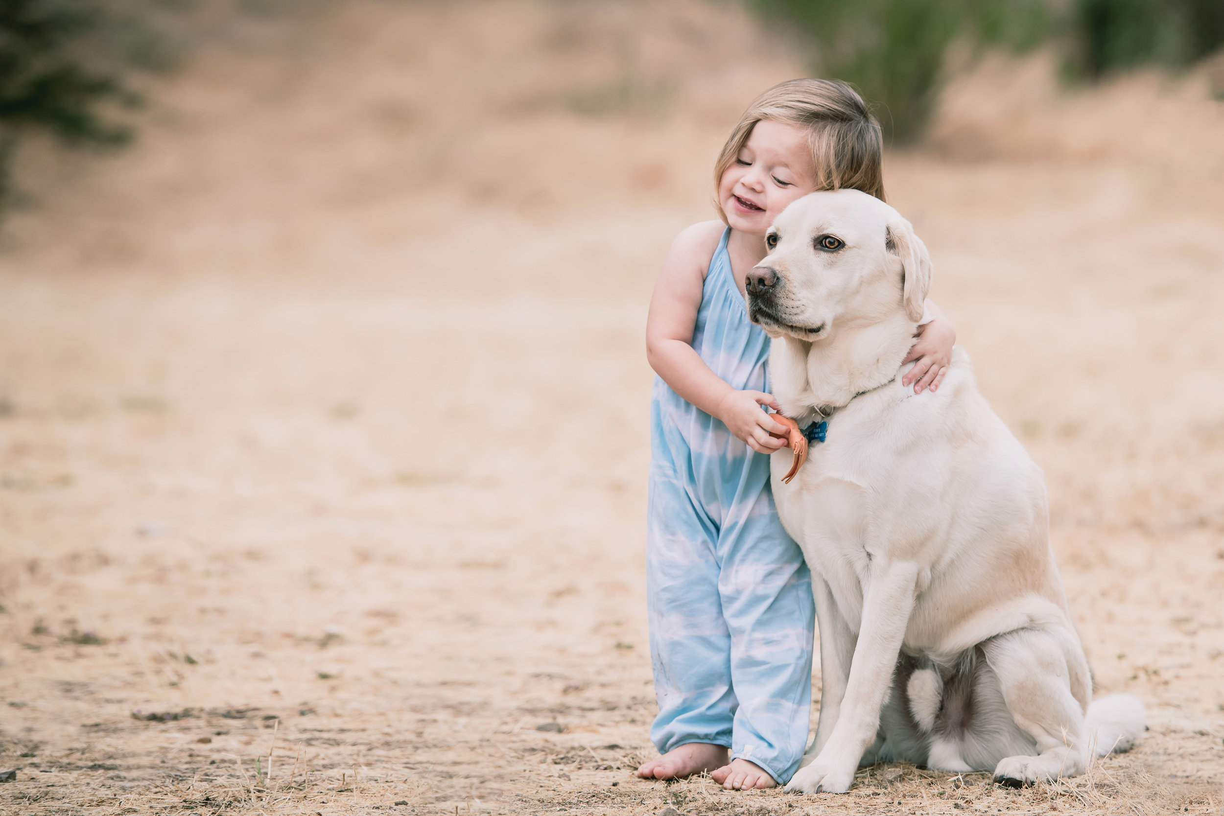 girl-hugging-dog-tokileephotography.jpg