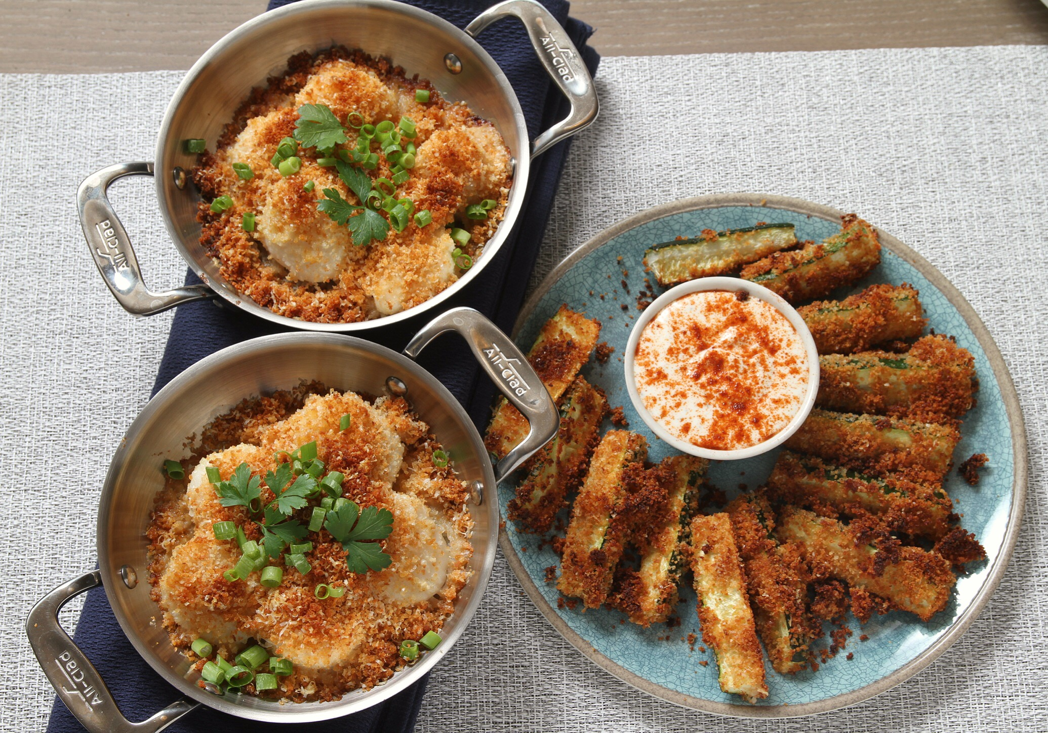Baked scallops and baked zucchini sticks.