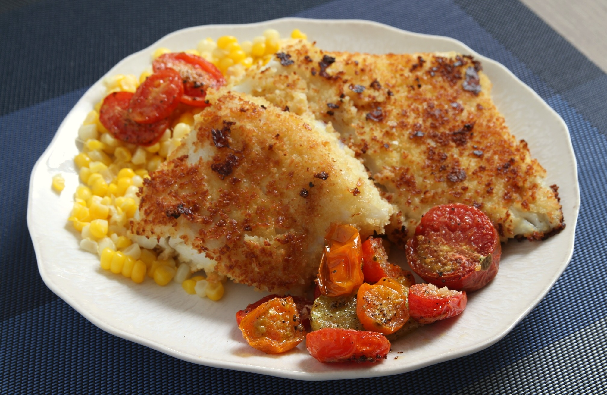 Pan fried cod with roasted tomatoes and corn.