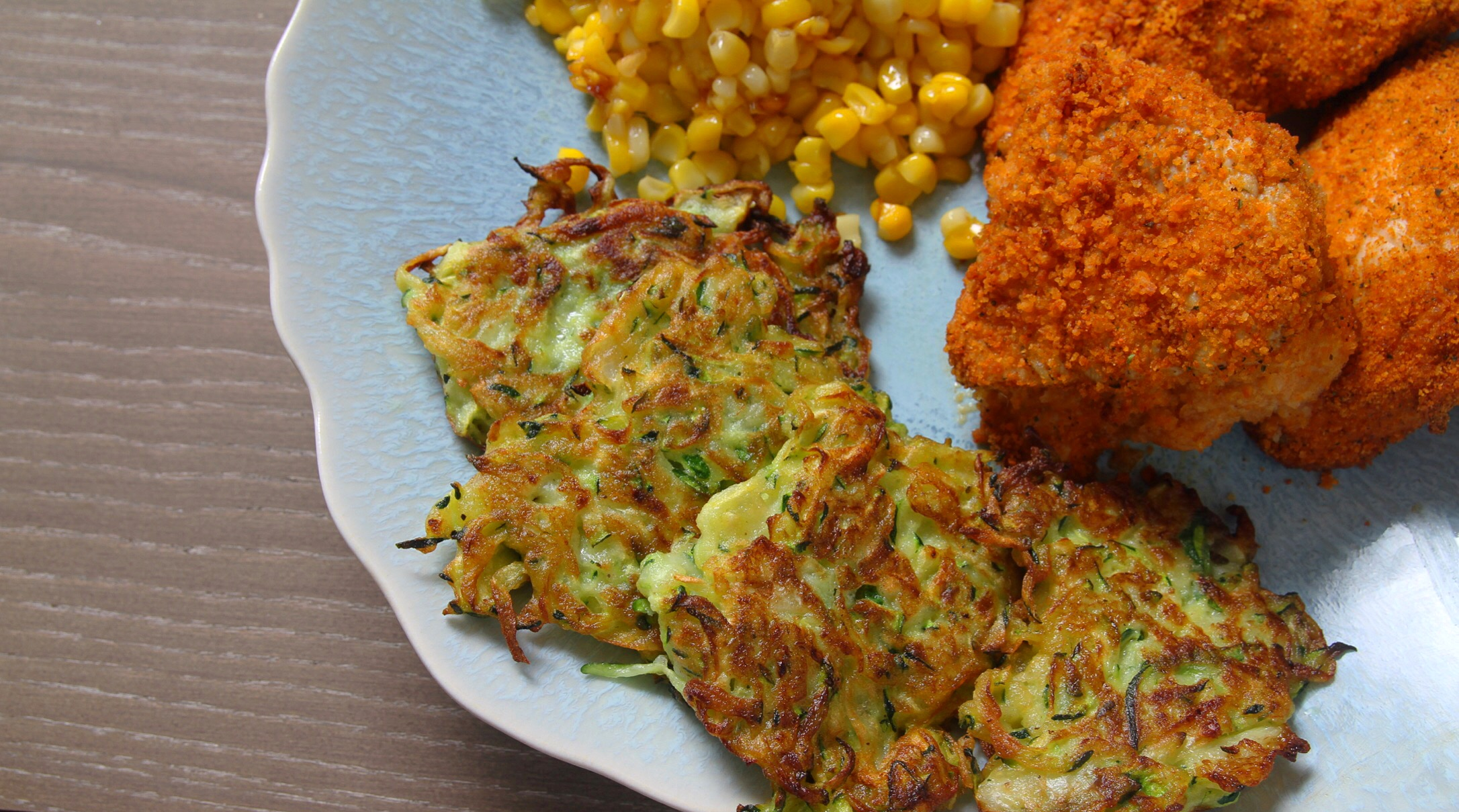 Zucchini fritters with corn and crispy baked chicken.