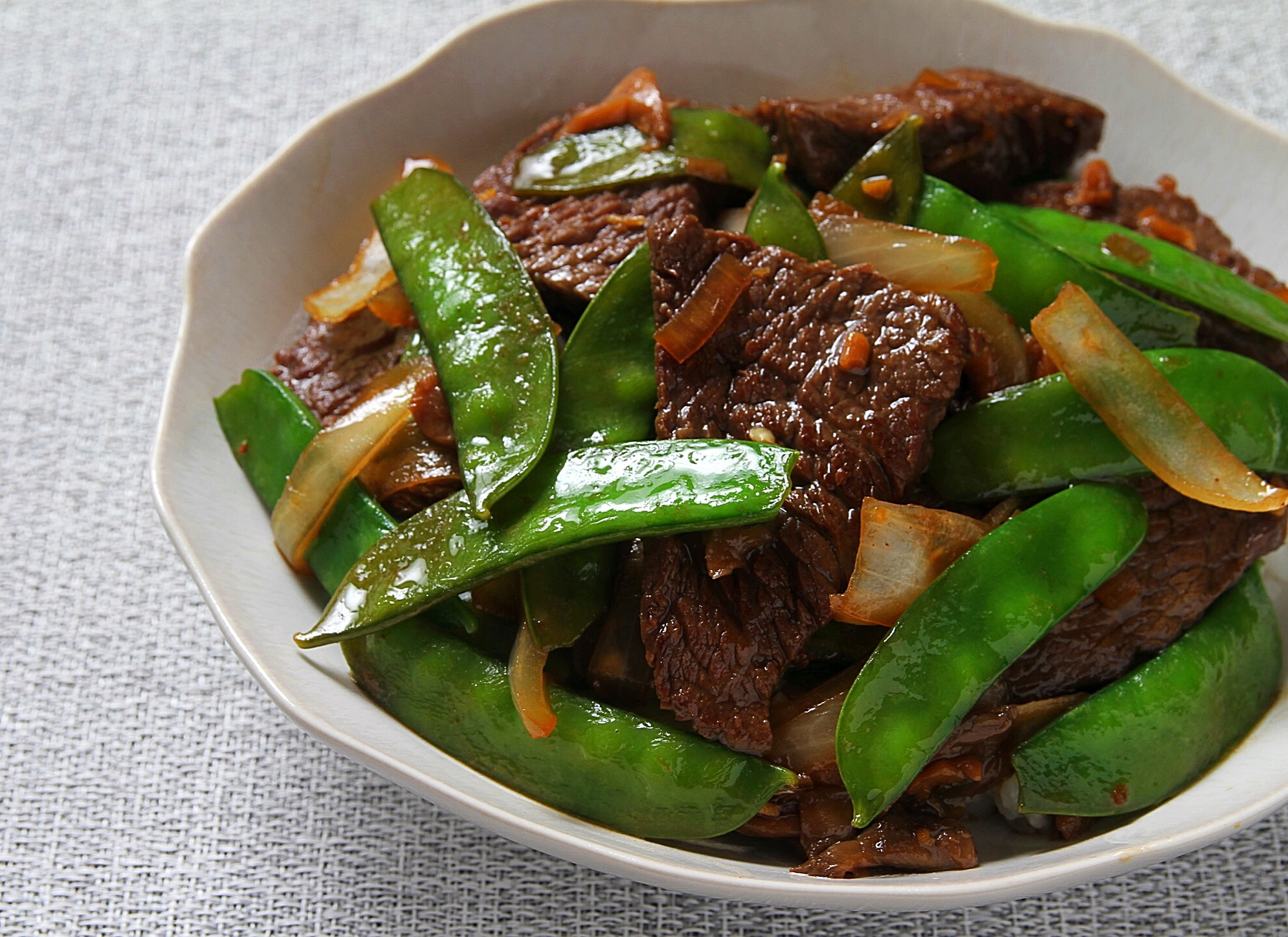 Asian flavored beef and snow pea stir fry.